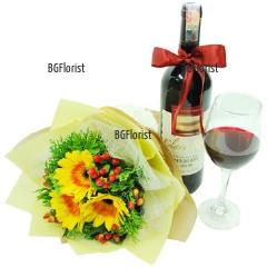 Доставка на букет от гербери и бутилка вино
