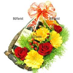 Подаръчен комплект от цветя и червено вино